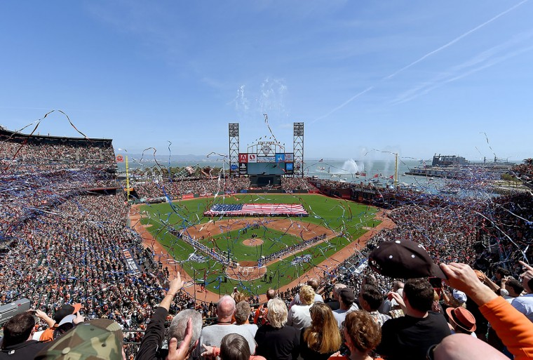 Colorado Rockies and the San Francisco Giants stand for the National Anthem prior to the start of the game on Opening Day at AT&T Park on April 13, 2015 in San Francisco, California. (Photo by Thearon W. Henderson/Getty Images)
