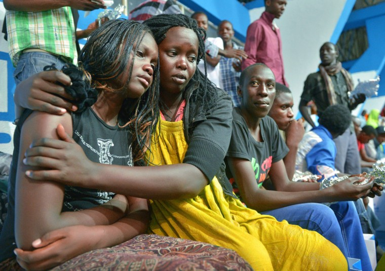 A survivor of an attack by islamist gunmen claimed by al-Shabab on a university campus in Garissa, northern Kenya is comforted by a colleague after arriving in Nairobi on April 4, 2015. Kenya's President, Uhuru Kenyatta vowed Saturday, to retaliate in the severest way against Somalia's al-Shabab islamists after they massacred nearly 150 people at a university. Tony Karumba/AFP Getty Images
