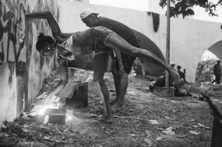 People living in park cook their dinner with a small fire in the Centro neighborhood on March 29, 2015 in Rio de Janeiro, Brazil.