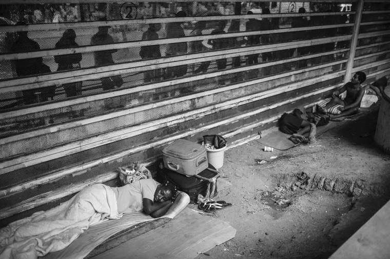 Luanda Goncalves (L) sleeps in the Centro neighborhood on March 24, 2015 in Rio de Janeiro, Brazil.