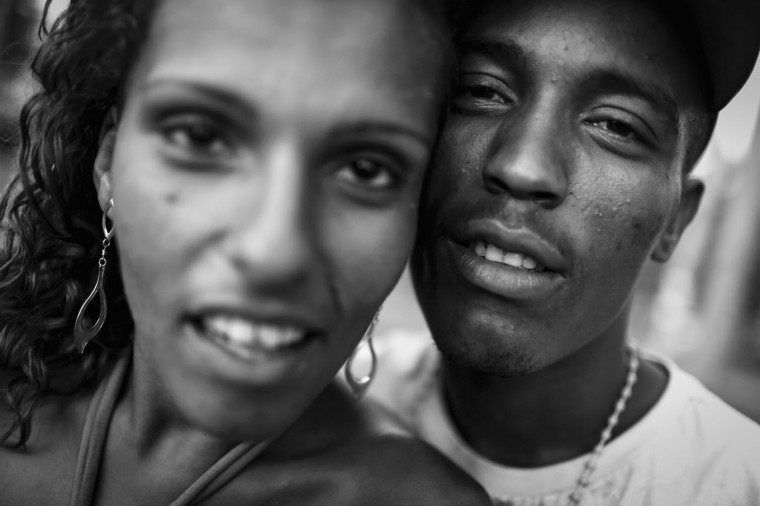 Vanessa Priscilla (L) poses with Ezekial in a park where homeless live in the West Zone on March 27, 2015 in Rio de Janeiro, Brazil. They both live in the park.