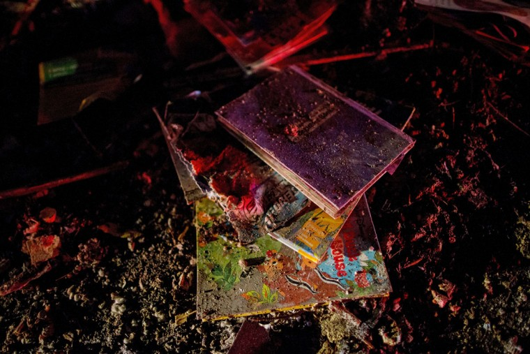 Books lay on the ground on IL-72 after a tornado came through the town earlier in the day on April 9, 2015 in Fairdale, Illinois. According to reports, seven people were injured and one person was killed when tornadoes and thunderstorms passed through the northwestern suburbs of Chicago. (Photo by Jon Durr/Getty Images)