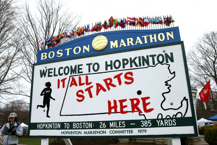 "BOSTON, MA - APRIL 20: A view of a sign stating ""It All Starts Here"" near the start in Hopkinton of the 119th Boston Marathon on April 20, 2015 in Boston, Massachusetts. (Photo by Maddie Meyer/Getty Images)"