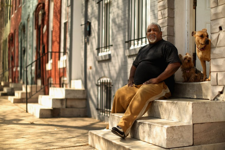 Earl Williams, a 40-year resident of Baltimore's Sandtown neighborhood, sits on the steps outside his home, around the corner from where Freddie Gray was arrested last week April 21, 2015 in Baltimore, Maryland. Gray, a 25-year-old black man who lived in the neighborhood, was arrested for possessing a switch blade knife April 12 outside this building on Baltimore's west side. According to his attorney, Gray died a week later in the hospital from a severe spinal cord injury he received while in police custody. 'There's a lot of us huring abou this death,' Williams said. 'Because it's so close to us.' (Photo by Chip Somodevilla/Getty Images)
