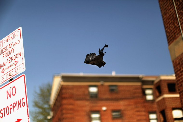 A black plastic shopping bag floats on the wind outside the Gilmor Homes housing project building where Freddie Gray was arrested last week in the Sandtown neighborhood April 21, 2015 in Baltimore, Maryland. Gray, a 25-year-old black man who lived in the neighborhood, was arrested for possessing a switch blade knife April 12 outside this building on Baltimore's west side. According to his attorney, Gray died a week later in the hospital from a severe spinal cord injury he received while in police custody. (Photo by Chip Somodevilla/Getty Images)