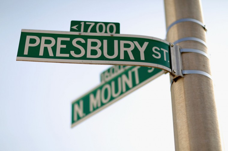 According to a police report Freddie Gray was arrested on the 1700 block of Presbury Street, outside the Gilmore Homes housing project in the Sandtown neighborhood, where this sign hangs April 21, 2015 in Baltimore, Maryland. Gray, a 25-year-old black man who lived in the neighborhood, was arrested for possessing a switch blade knife April 12 outside this building on Baltimore's west side. According to his attorney, Gray died a week later in the hospital from a severe spinal cord injury he received while in police custody. (Photo by Chip Somodevilla/Getty Images)