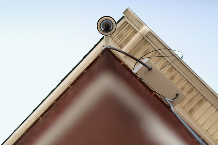 This video surveillance cameras is mounted to the outside of the Gilmor Homes housing project building above the place where Freddie Gray was arrested in the Sandtown neighborhood April 21, 2015 in Baltimore, Maryland. Gray, a 25-year-old black man who lived in the neighborhood, was arrested for possessing a switch blade knife April 12 outside this building on Baltimore's west side. According to his attorney, Gray died a week later in the hospital from a severe spinal cord injury he received while in police custody. (Photo by Chip Somodevilla/Getty Images)