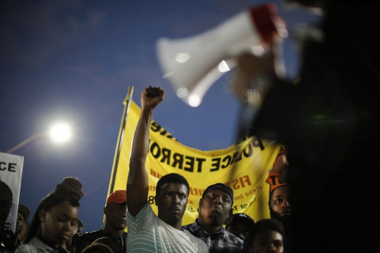 Protestors participate in a vigil for Freddie Gray down the street from the Baltimore Police Department's Western District police station, April 21, 2015 in Baltimore, Maryland. Gray, 25, died from spinal injuries on April 19, one week after being taken into police custody. (Photo by Drew Angerer/Getty Images)