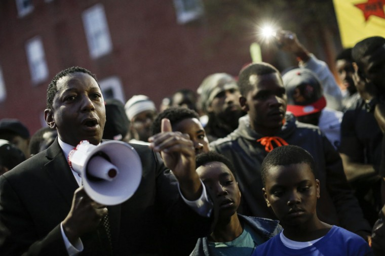 Maryland State Delegate Keith E. Haynes talks to protestors during a vigil for Freddie Gray down the street from the Baltimore Police Department's Western District police station, April 21, 2015 in Baltimore, Maryland. Gray, 25, died from spinal injuries on April 19, one week after being taken into police custody. (Photo by Drew Angerer/Getty Images)