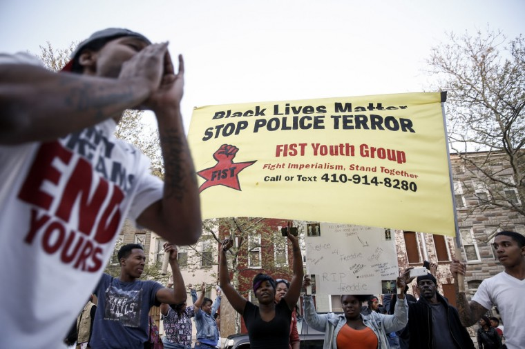 Protestors shout at the police after a march for Freddie Gray that ended in front of the Baltimore Police Department's Western District police station, April 21, 2015 in Baltimore, Maryland. Gray, 25, died from spinal injuries on April 19, one week after being taken into police custody. (Photo by Drew Angerer/Getty Images)