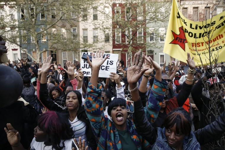 Protestors rally after a march for Freddie Gray that ended in front of the Baltimore Police Department's Western District police station, April 21, 2015 in Baltimore, Maryland. Gray, 25, died from spinal injuries on April 19, one week after being taken into police custody. (Photo by Drew Angerer/Getty Images)