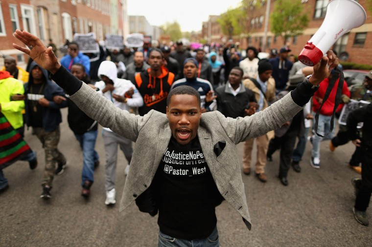Hundreds of demonstrators march toward the Baltimore Police Western District station during a protest against police brutality and the death of Freddie Gray in the Sandtown neighborhood April 22, 2015 in Baltimore, Maryland. Gray, 25, was arrested for possessing a switch blade knife April 12 outside the Gilmor Homes housing project on Baltimore's west side. According to his attorney, Gray died a week later in the hospital from a severe spinal cord injury he received while in police custody. (Photo by Chip Somodevilla/Getty Images)