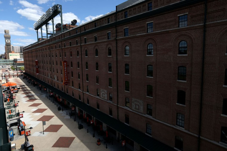 An entrance sits empty before the Baltimore Orioles play the Chicago White Sox at an empty Oriole Park at Camden Yards on April 29, 2015 in Baltimore, Maryland. Due to unrest in relation to the arrest and death of Freddie Gray, the two teams played in a stadium closed to the public. Gray, 25, was arrested for possessing a switch blade knife April 12 outside the Gilmor Houses housing project on Baltimore's west side. According to his attorney, Gray died a week later in the hospital from a severe spinal cord injury he received while in police custody. (Photo by Patrick Smith/Getty Images)