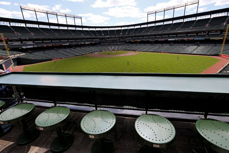The Baltimore Orioles play the Chicago White Sox in the first inning at an empty Oriole Park at Camden Yards on April 29, 2015 in Baltimore, Maryland. Due to unrest in relation to the arrest and death of Freddie Gray, the two teams played in a stadium closed to the public. Gray, 25, was arrested for possessing a switch blade knife April 12 outside the Gilmor Houses housing project on Baltimore's west side. According to his attorney, Gray died a week later in the hospital from a severe spinal cord injury he received while in police custody. (Photo by Patrick Smith/Getty Images)