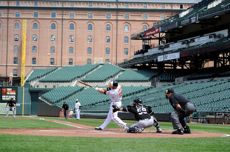 Chris Davis #19 of the Baltimore Orioles hits a three-run home run in the first inning against the Chicago White Sox at Oriole Park at Camden Yards on April 29, 2015 in Baltimore, Maryland. The game was played without spectators due to the social unrest in Baltimore. (Photo by Greg Fiume/Getty Images)