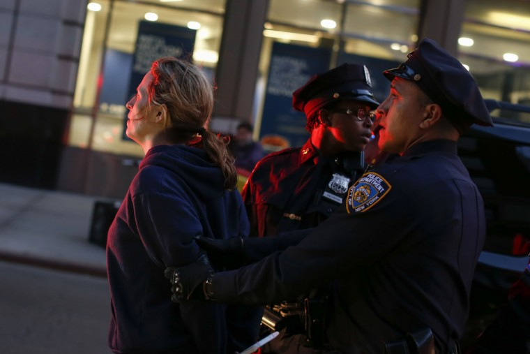 A woman is arrested during a Solidarity With City Of Baltimore protest on April 29, 2015 in New York City. Baltimore, Maryland remains on edge in the wake of the death of Freddie Gray, though the city has been largely peaceful following a day of rioting this past Monday. Gray, 25, was arrested for possessing a switch blade knife April 12 outside the Gilmor Houses housing project on Baltimore's west side. According to his attorney, Gray died a week later in the hospital from a severe spinal cord injury he received while in police. (Kena Betancur/Getty Images)