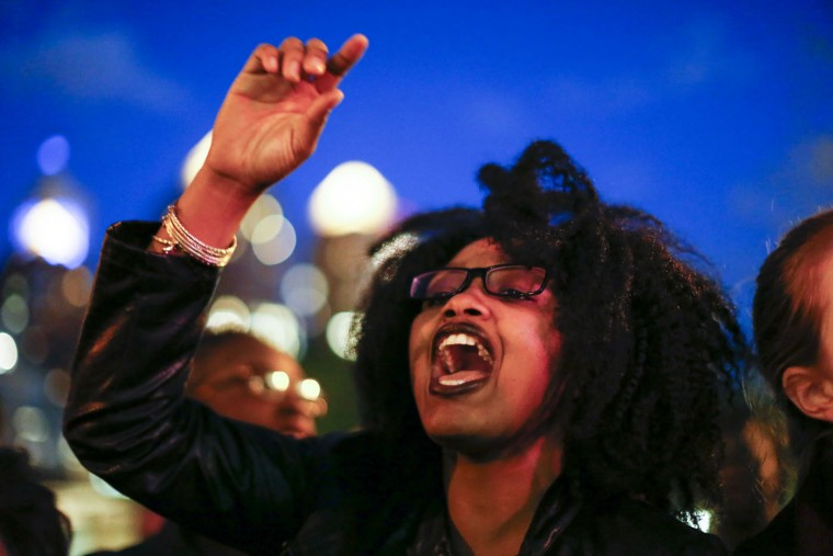 A woman takes part in a Solidarity With City Of Baltimore rally at Union Square on April 29, 2015 in New York City. in Baltimore, Maryland remains on edge in the wake of the death of Freddie Gray, though the city has been largely peaceful following a day of rioting this past Monday. Gray, 25, was arrested for possessing a switch blade knife April 12 outside the Gilmor Houses housing project on Baltimore's west side. According to his attorney, Gray died a week later in the hospital from a severe spinal cord injury he received while in police custody. (Kena Betancur/Getty Images)