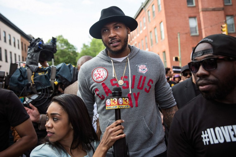 NBA star Carmelo Anthony of the New York Knicks marches with protesters from the Sandtown neighborhood to City Hall demanding better police accountability and racial equality following the death of Freddie Gray on April 30, 2015 in Baltimore, Maryland. Gray, 25, was arrested for possessing a switch blade knife April 12 outside the Gilmor Houses housing project on Baltimore's west side. According to his attorney, Gray died a week later in the hospital from a severe spinal cord injury he received while in police custody. (Photo by Andrew Burton/Getty Images)