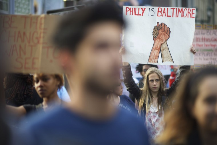 Protestors march over the death of Freddie Gray on April 30, 2015 in Philadelphia, Pennsylvania. Freddie Gray, 25, was arrested for possessing a switch blade knife April 12 outside the Gilmor Houses housing project on Baltimore's west side. According to his attorney, Gray died a week later in the hospital from a severe spinal cord injury he received while in police custody. (Photo by Mark Makela/Getty Images)