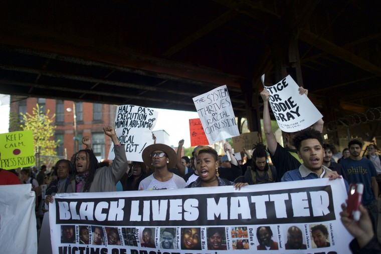Protestors demonstrate over the death of Freddy Gray on April 30, 2015 in Philadelphia, Pennsylvania. Freddie Gray, 25, was arrested for possessing a switch blade knife April 12 outside the Gilmor Houses housing project on Baltimore's west side. According to his attorney, Gray died a week later in the hospital from a severe spinal cord injury he received while in police custody. (Photo by Mark Makela/Getty Images)