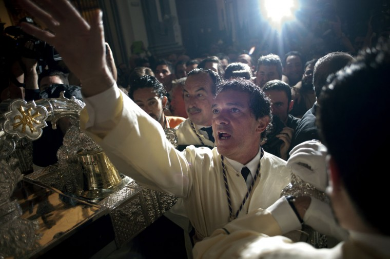 Spanish actor Antonio Banderas takes part in the 'Lagrimas y Favores' brotherhood procession on March 29, 2015 in Malaga, during the Holy Week. Christian believers around the world mark the Holy Week of Easter in celebration of the crucifixion and resurrection of Jesus Christ. (Jorge Guerrero/AFP/Getty Images)