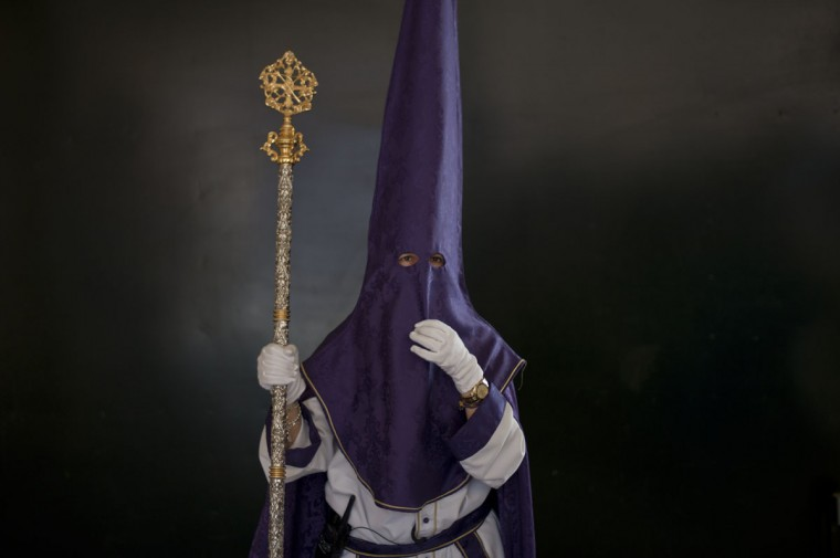 A penitent waits to take part in the Huerto brotherhood procession on March 29, 2015 in Malaga, during the Holy Week. Christian believers around the world mark the Holy Week of Easter in celebration of the crucifixion and resurrection of Jesus Christ. (Jorge Guerrero/AFP/Getty Images)