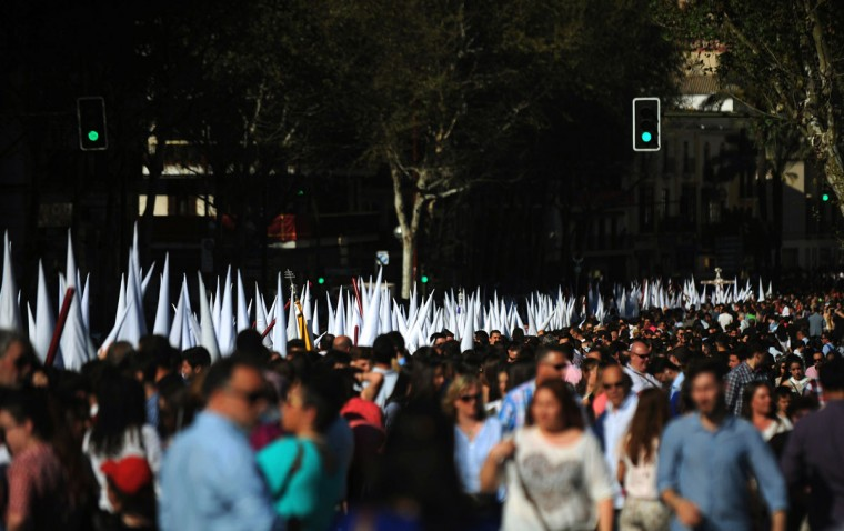 Penitents take part in the San Gonzalo brotherhood procession in Sevilla on March 30, 2015. Christian believers around the world mark the Holy Week of Easter in celebration of the crucifixion and resurrection of Jesus Christ. (AFP Photo/Cristina Quicler)