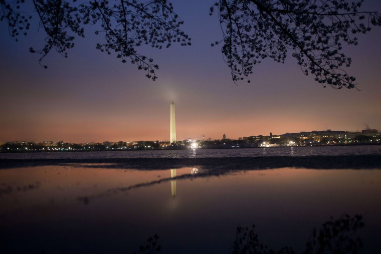 The Washington Monument is seen with cherry blossoms across the tidal basin on the National Mall on April 9, 2015 in Washington, DC. The cherry trees on the National Mall, originally a gift from Japan, have begun to blossom with spring's arrival. (Brendan Smialowski/AFP/Getty Images)