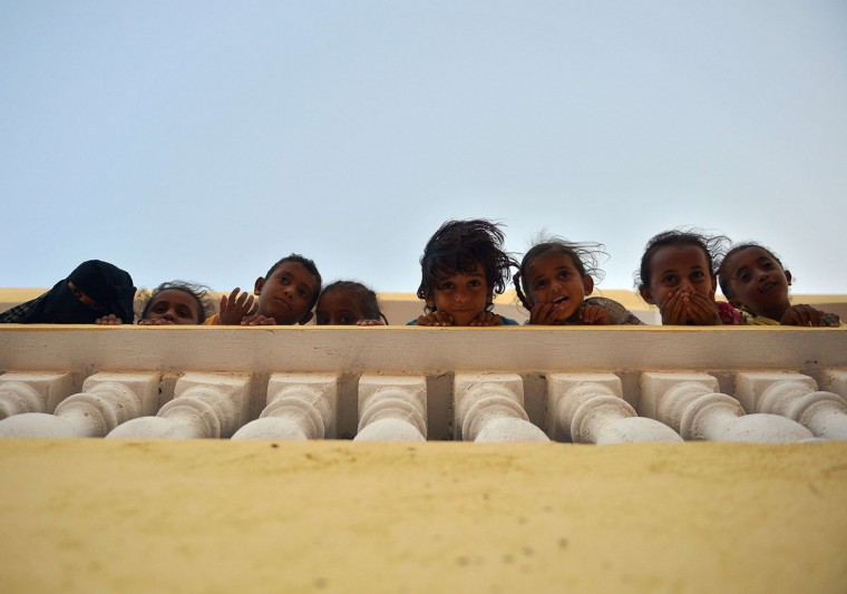 Yemeni refugee children stand on April 12, 2015 at a boarding fracility run by the UN High Commission for Refugees in Obock, a small port in Djibouti on the northern shore of the Gulf of Tadjoura, where it opens out into the Gulf of Aden. The UN said at least 900 people had arrived in the Horn of Africa in the past 10 days, including 344 Yemenis who sought refuge in Djibouti even as fresh Saudi-led air strikes pounded rebel positions across south Yemen on April 13. (AFP Photo/Tony Karumba)