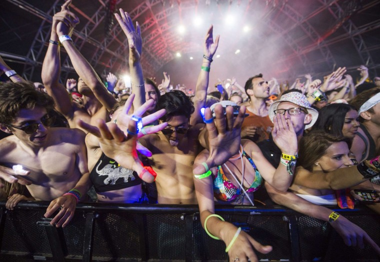 Festival-goers watch as David Guetta performs on day three of the Coachella Music Festival in Indio, California, April 12, 2015. (AFP Photo/Robyn Beck)