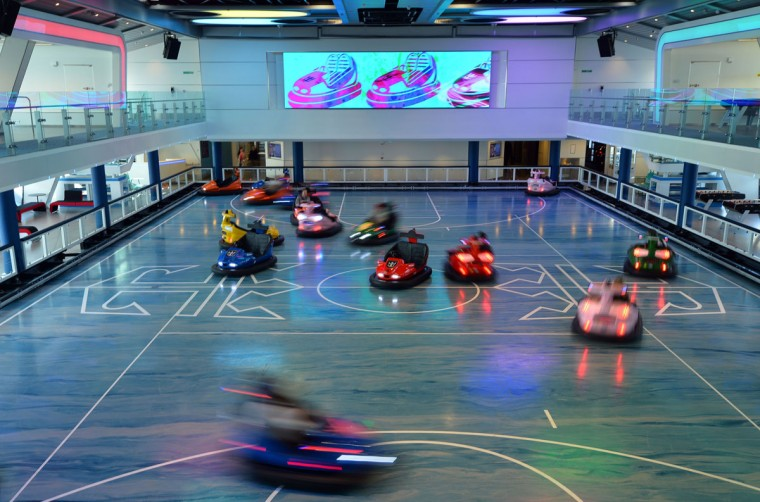 Guests enjoy the bumper cars on Royal Caribbean's latest cruise liner 'The Anthem Of The Seas', a 4,905-passenger ship which is docked in Southampton on April 20, 2015. (GLYN KIRK/AFP/Getty Images)