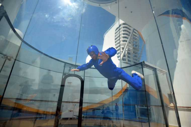 An instructor uses the skydiving simulator on board the Royal Caribbean's latest cruise liner 'The Anthem Of The Seas', a 4,905-passenger ship which is docked in Southampton on April 20, 2015. (GLYN KIRK/AFP/Getty Images)