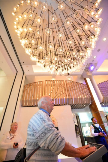A guest uses the 'Pulse Spiral', an interactive chandelier on board Royal Caribbean's latest cruise liner 'The Anthem Of The Seas', a 4,905-passenger ship which is docked in Southampton on April 20, 2015. (GLYN KIRK/AFP/Getty Images)