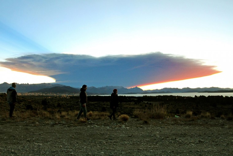 View from the Nahuel Huapi lake, province of Rio Negro, 1570 km southwest of Buenos Aires, of a menacing cloud from the Calbuco volcano in neighbouring Chile, on April 22, 2015. Chile's Calbuco volcano erupted on Wednesday, spewing a giant funnel of ash high into the sky near the southern port city of Puerto Montt and triggering a red alert. Authorities ordered an evacuation for a 10-kilometer (six-mile) radius around the volcano, which is the second in southern Chile to have a substantial eruption since March 3, when the Villarrica volcano emitted a brief but fiery burst of ash and lava. (AFP Photo/P /francisco )