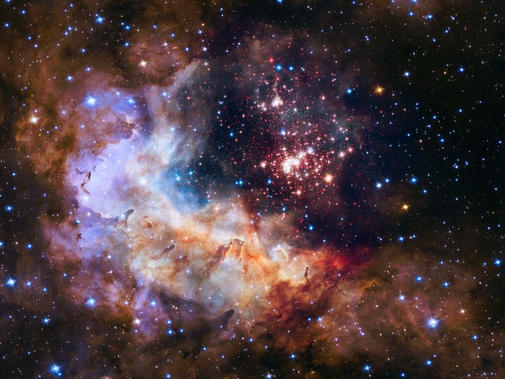 This NASA/ESA Hubble Space Telescope image of the cluster Westerlund 2 and its surroundings has been released to celebrate Hubble's 25th year in orbit. The image's central region, containing the star cluster, blends visible-light data taken by the Advanced Camera for Surveys and near-infrared exposures taken by the Wide Field Camera 3. The surrounding region is composed of visible-light observations taken by the Advanced Camera for Surveys. AFP PHOTO / HO / EUROPEAN SOUTHERN OBSERVATORY