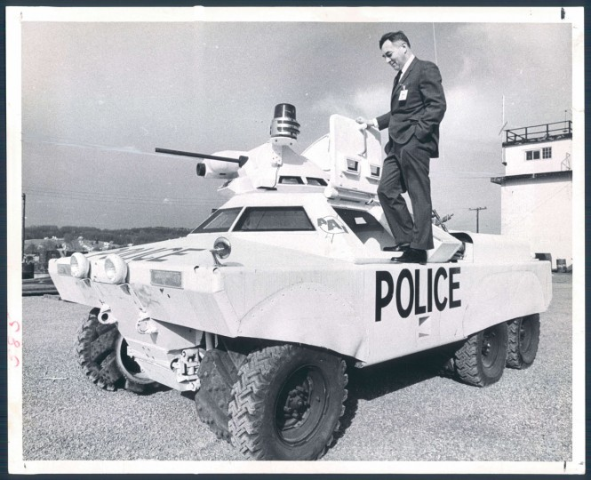 February 29, 1968 - JUST IN CASE -- Irwin R. Barr, vice president of the AAI Corporation, stands on top of the police riot vehicle which the company manufactures near Cockeysville, Md. Photo by William L. LaForce.