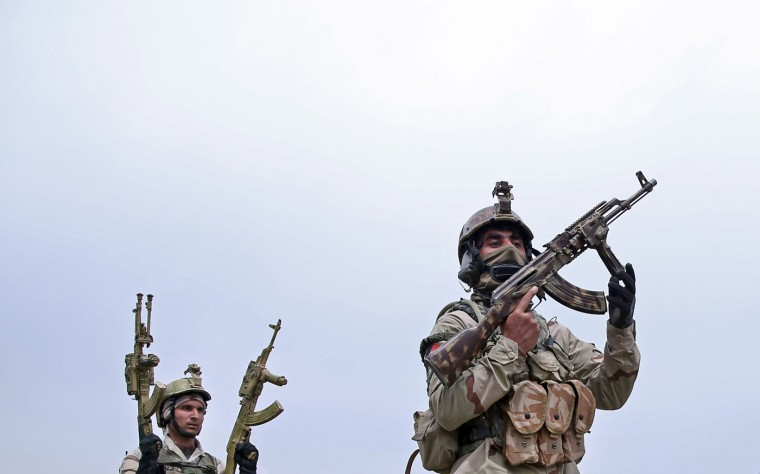 Afghanistan's interior ministry special forces take position during a military exercise in Kabul, Afghanistan, Thursday, April 2, 2015. Afghanistan's security forces took over full responsibility for the country's security on Jan. 1, 2015. (AP Photo/Massoud Hossaini)