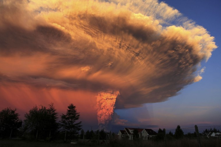The Calbuco volcano erupts near Puerto Varas, Chile, Wednesday, April 22, 2015. The Calbuco volcano erupted Wednesday for the first time in more than 42 years, billowing a huge ash cloud over a sparsely populated, mountainous area in southern Chile. Authorities ordered the evacuation of the 1,500 inhabitants of the nearby town of Ensenada, along with residents of two smaller communities. (AP Photo/Diego Main/Aton Chile)