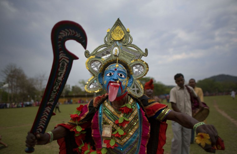 A man dressed as Hindu goddess Kali dances during the Suwori festival in Boko about 75 kilometers (47 miles) west of Gauhati, India, Monday, April 20, 2015. Traditional elephant fights, elephant races, tug of war and dances mark this festival which coincides with the Assamese Rongali Bihu, or the harvest festival of the northeastern Indian state of Assam. (AP Photo/ Anupam Nath)
