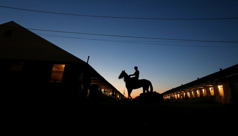 A rider and horse head to the track for an early morning workout at Churchill Downs Monday, April 27, 2015, in Louisville, Ky. (AP Photo/Charlie Riedel)