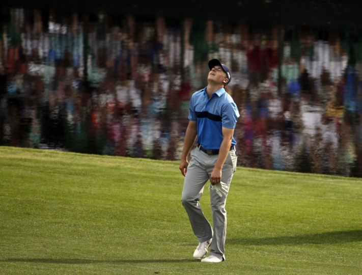 Jordan Spieth reacts after his shot the 15th green during the first round of the Masters golf tournament Thursday, April 9, 2015, in Augusta, Ga. (AP Photo/Darron Cummings)