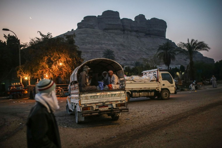 Quarry workers are transported in pickup trucks after dawn from Shurafa village, Minya, southern Egypt. Around 45,000 people, including children, work in an estimated 1,500 quarries, digging out stones that later will be used in construction or powdered to be used by pharmaceutical and ceramic companies.(AP Photo/Mosa'ab Elshamy)