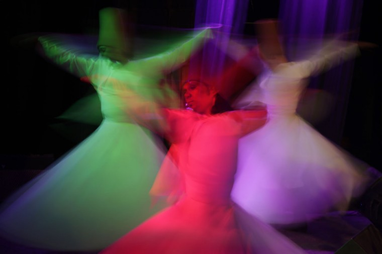 "Egyptian dancers in traditional costumes perform Sufi dance known as ""whirling dervish"" in Cairo, Egypt, Thursday, April 23, 2015. Whirling dervishes of al-Tannura entertain visitors with their colorful and artistic spinning dance. (AP Photo/Amr Nabil)"