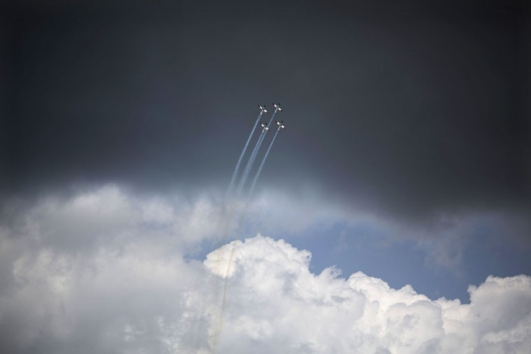 Israeli Air Force planes fly over the Mediterranean sea during Israel's 67th Independence Day, in Tel Aviv, Thursday, April 23, 2015. Israel is celebrating its annual Independence Day, marking 67 years since the founding of the state in 1948. (AP Photo/Ariel Schalit)