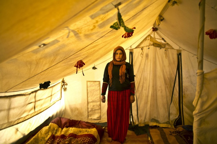 "In this Monday, March 16, 2015 photo, pregnant Syrian refugee Wadhah Hamada, 22, poses for a portrait inside her tent at an informal settlement near the Syrian border, on the outskirts of Mafraq, Jordan. Hamada, who fled al-Hasaka, Syria, says she has no clue how her four-month pregnancy is progressing. ""I can't afford to pay 50 Jordanian dinars ($70) for my ultrasound and other medical checks,î she says. ìOur future is dark, my life is in a tent and my first child's life won't be different."" (AP Photo/Muhammed Muheisen)"