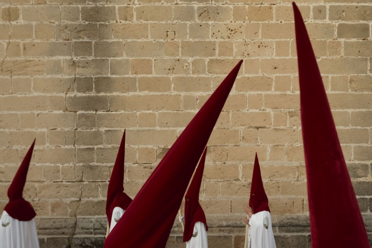 Penitents take part in a Holy Week procession in Jerez de la Frontera, Spain, Monday, March 30, 2015. Hundreds of processions take place throughout Spain during the Easter Holy Week. (AP Photo/Daniel Ochoa de Olza)