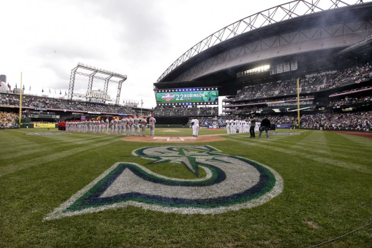 Players line up along the baselines before the Seattle Mariners' home opener against the Los Angeles Angels Monday, April 6, 2015, in Seattle. (AP Photo/Elaine Thompson)