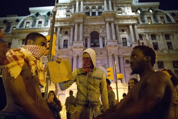 Protesters pause during a march at City Hall in Philadelphia on Thursday, April 30, 2015. The event in Philadelphia follows days of unrest in Baltimore amid Freddie Gray's police-custody death. (AP Photo/Matt Rourke)