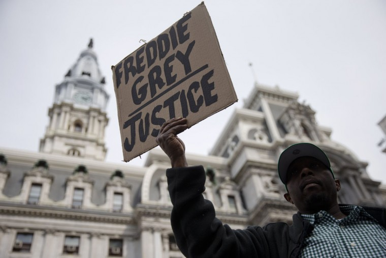 Daniel H Smith demonstrates outside City Hall in Philadelphia on Thursday, April 30, 2015. The event in Philadelphia follows days of unrest in Baltimore amid Freddie Gray's police-custody death. (AP Photo/Matt Rourke)