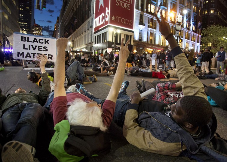Protestors lay in the street to stage a die-in at Herald Square, Wednesday, April 29, 2015, in New York. Several hundred people gathered in New York on Wednesday to protest the death of Freddie Gray, a Baltimore man who was critically injured in police custody, and more than a dozen were arrested. (AP Photo/Julie Jacobson)